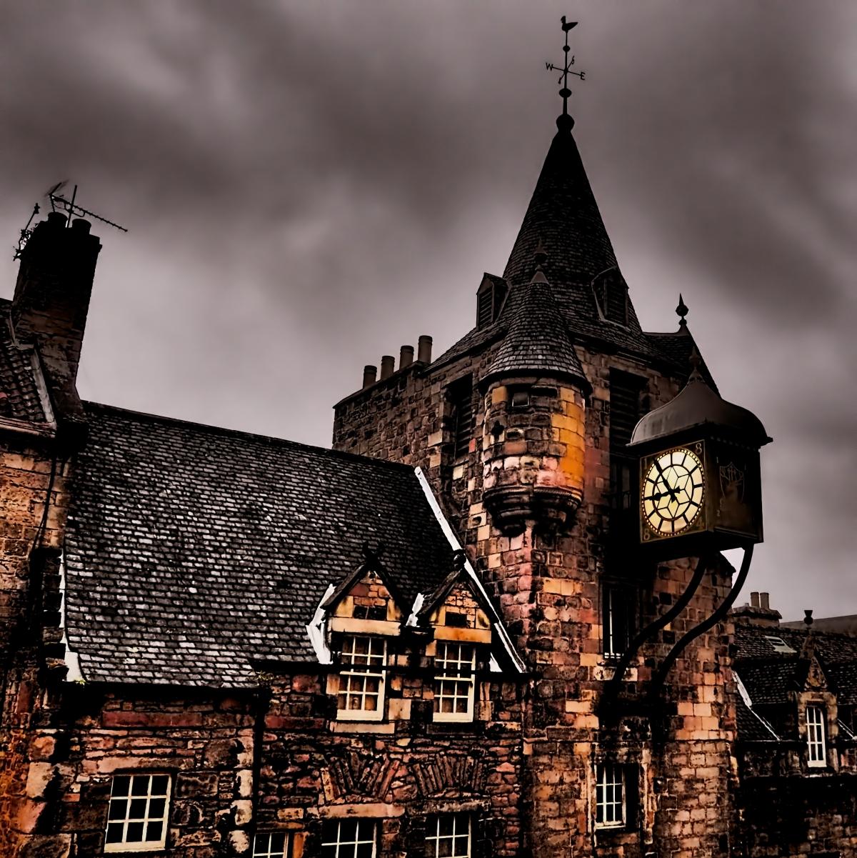 Edinburgh's Tolbooth Tavern Clock Tower at night