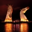 Scottish myths and legends. The Kelpies monument in Falkirk lit up in yellow.
