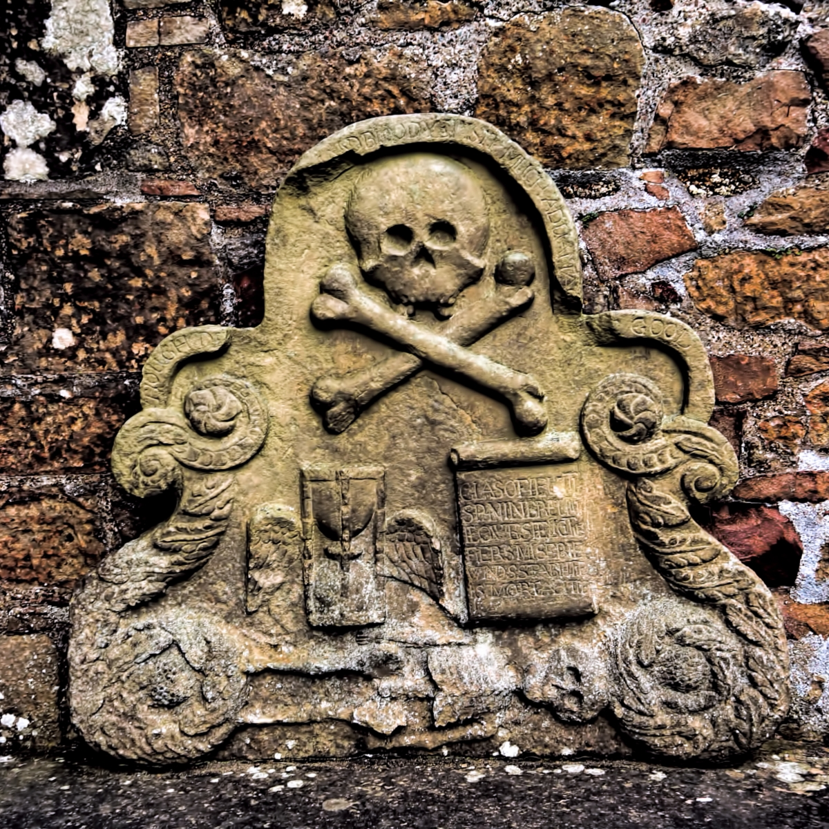 Scottish graveyard symbols on a medieval tombstone.