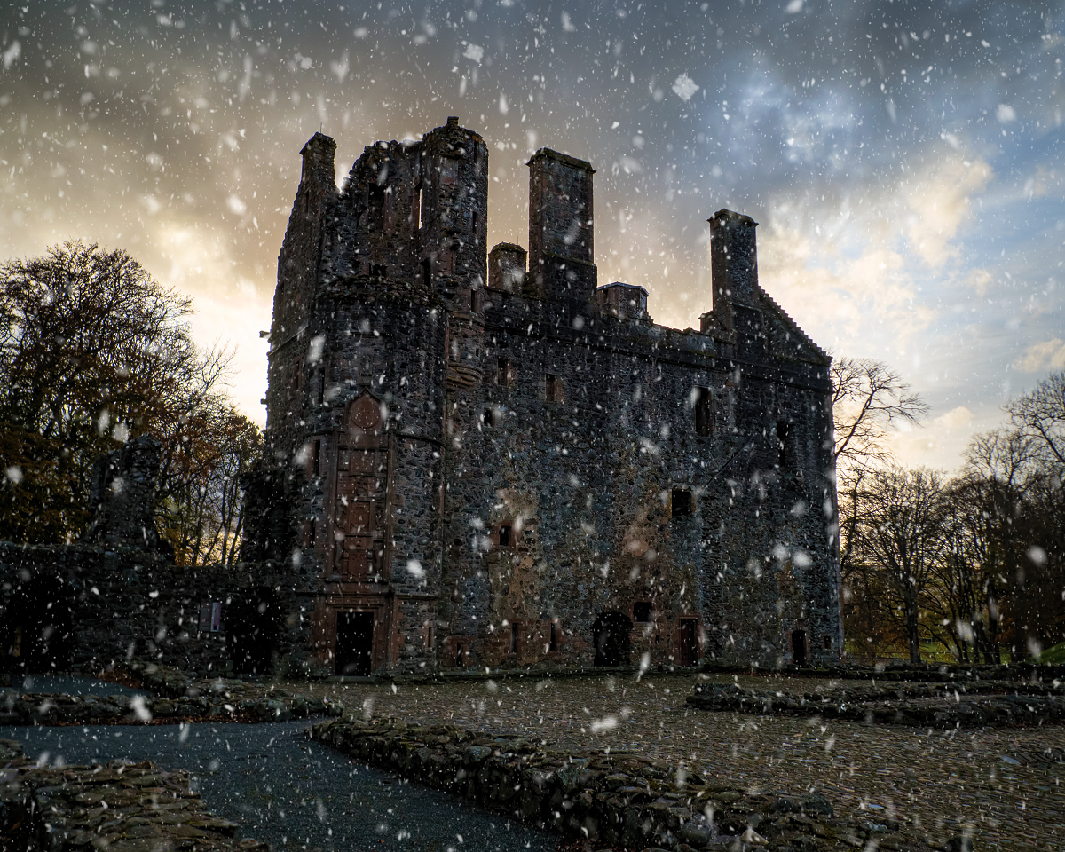 Snow falling at Huntly Castle on Christmas in Scotland.