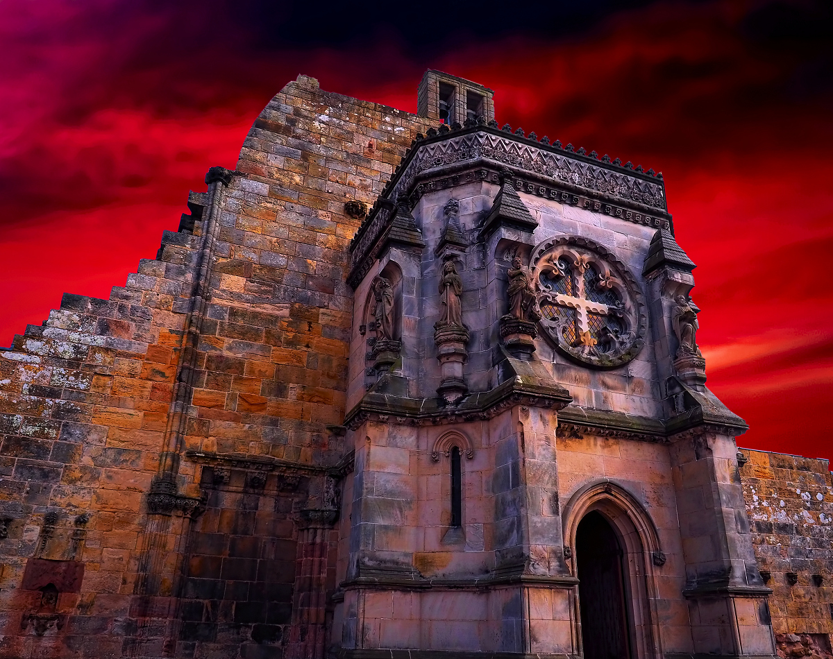 Rosslyn Chapel lit by a fiery sunset