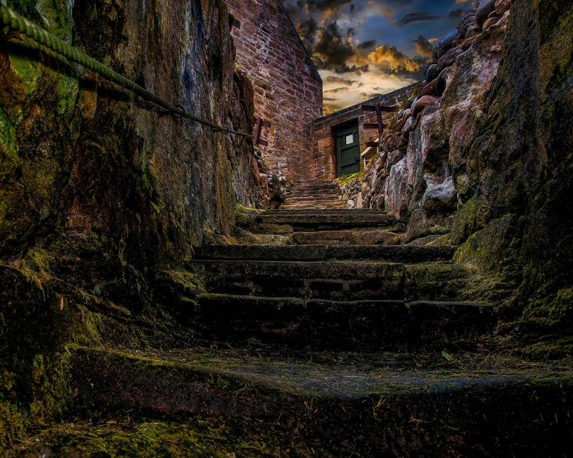 Steps leading down into an ancient underground well in Burghead, Scotland